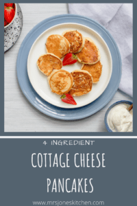 Easy and healthy pancakes on plate served with strawberries and yogurt
