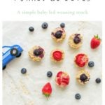 blw snack recipe porridge bites with strawberries and blueberries next to a blue toy car.