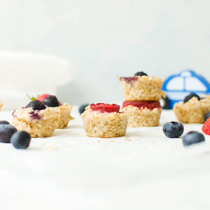porridge bites piled on top of each other with a blue toy car in the background
