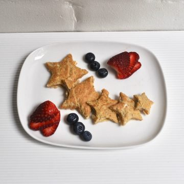 eggy bread cut into star shapes served with blueberries and strawberries