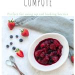 mixed berry compote in bowl with strawberries and blueberries