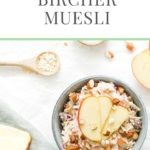 bircher muesli with apple, almonds, sultanas and oats in blue bowl