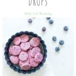 baby led weaning blueberry yogurt drops in round dish scattered with blueberries