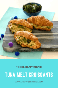 tuna melt croissants on dark marble board
