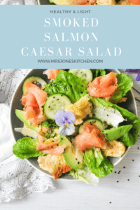 healthy caesar salad with salmon in a bowl