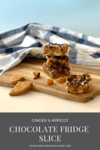 ginger and apricot chocolate fridge slice on wooden board with blue and white tea towel in background