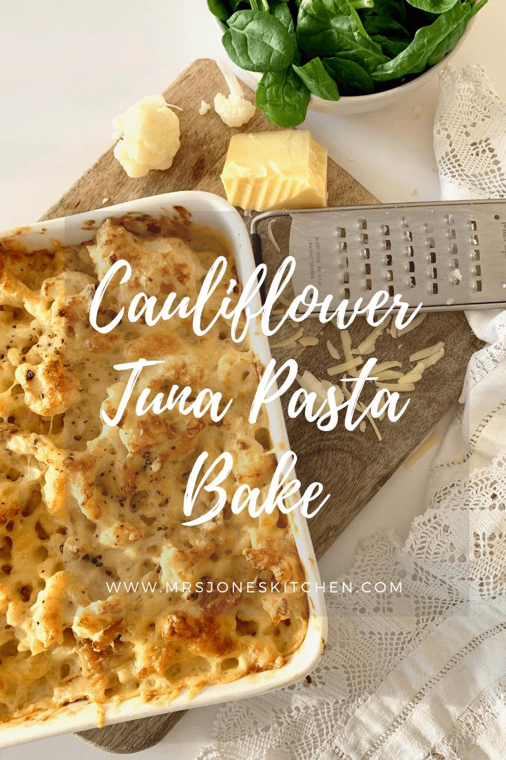 tuna pasta bake in white dish on wooden chopping board