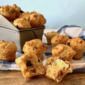 Soda bread muffins in baking tin and on wooden board