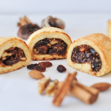 mince pie fig rolls with cinnamon sticks, dried fruit and nuts