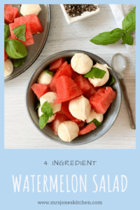 Watermelon basil and mozzarella salad in blue bowl