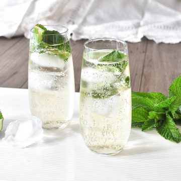 two glasses of hugo cocktail with mint