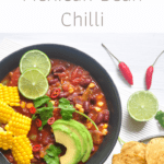 vegan chilli topped with avocado and corn
