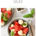 watermelon salad in blue bowl with basil