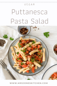 plant based puttanesca pasta salad with tomatoes and olives