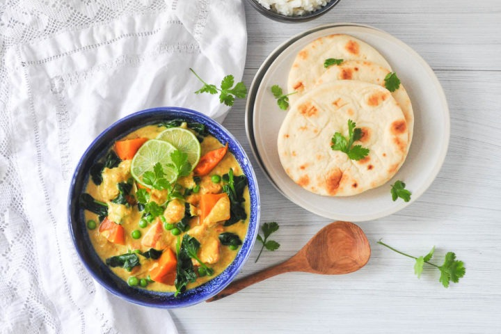 satay pumpkin curry served with naan bread and rice sprinkled with fresh coriander