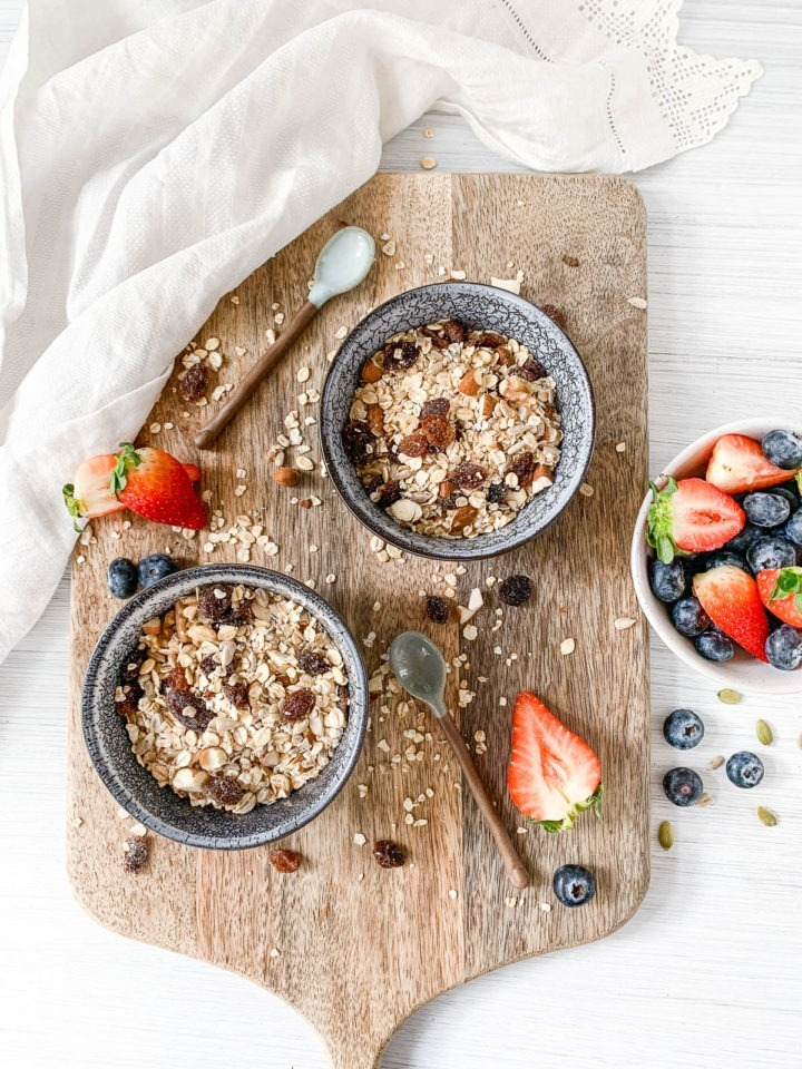 vertical shot of muesli in bowls with fresh berries