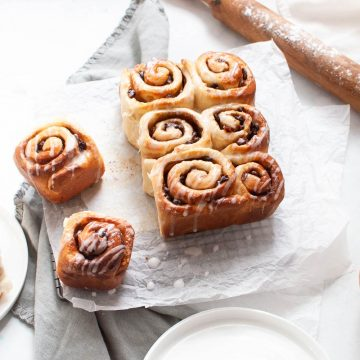 freshly baked chelsea buns drizzled with icing