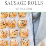 vegetarian sausage rolls sprinkled with sesame seeds on cooking rack