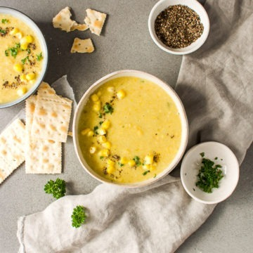 Bowl of sweetcorn leek chowder with crackers