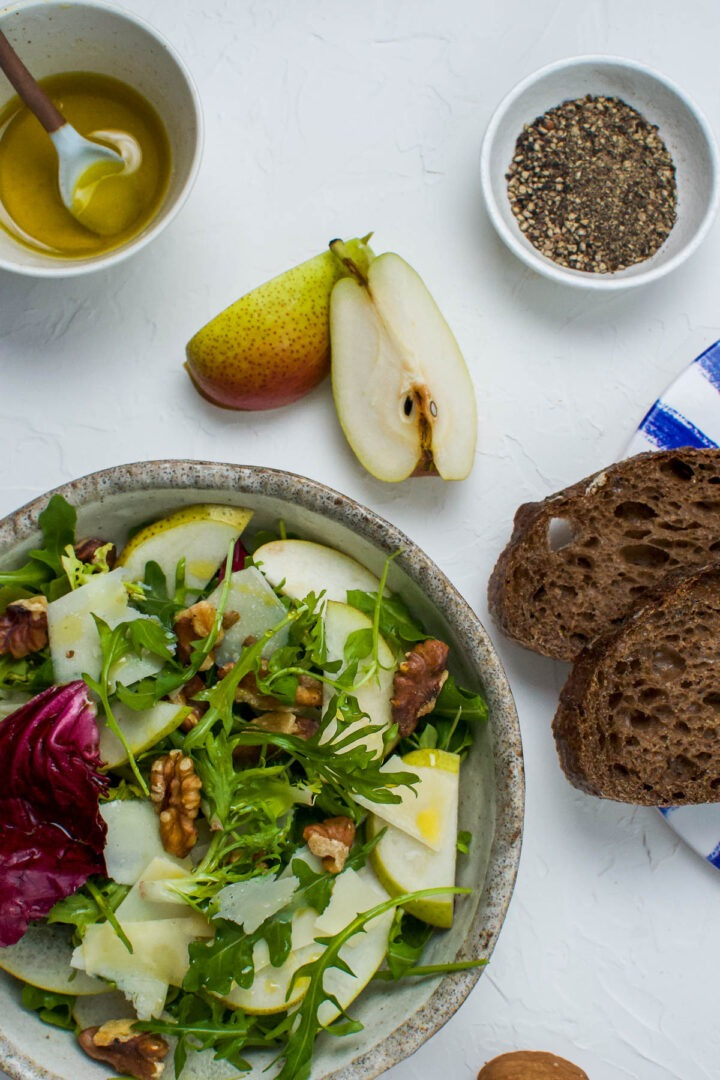 pear salad with Italian leaves, walnut and shaved parmesan served with dark rye bread, with extra lemon vinaigrette on the side