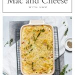 pin for cauliflower mac and cheese with ham showing the pasta bake in the baking dish