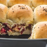 close up of turkey sliders with cranberry sauce with