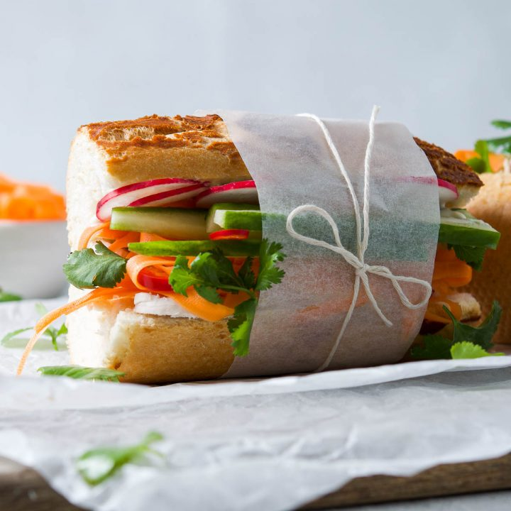 close up of the side of the banh mi baguette to show the layers of colourful ingredients