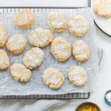 overhead shot of ricciarelli almond biscuits on a cooling rack to show the crackled top