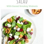 pin for beetroot and feta salad with sweet smokey walnuts, on one white plate