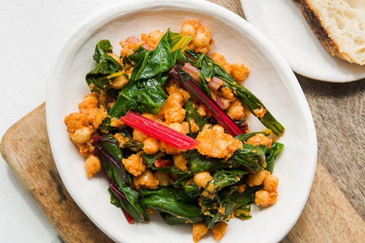 rainbow chard silverbeet with chickpeas in a shallow white tapas bowl