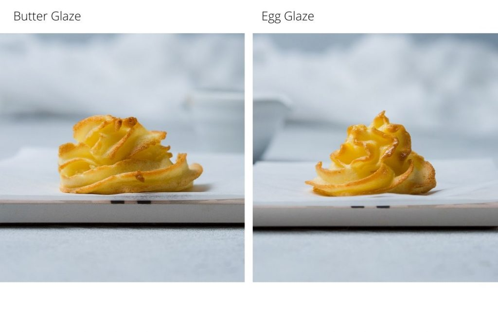 an image to show the minor difference between brushing the potaotes with melted butter or egg before making (the egg glaze on the left makes them slightly shinier)