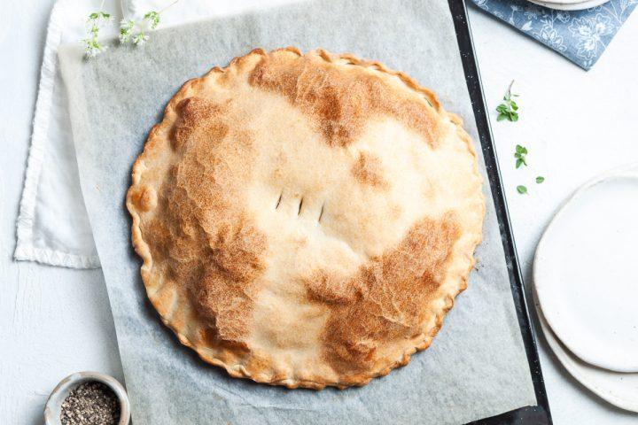 Erbazzone taken from overhead showing the full uncut silverbeet pie pie.