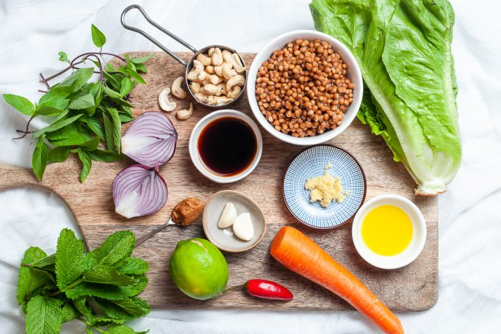 Thai Lettuce Cups ingredients displayed on a wooden board.