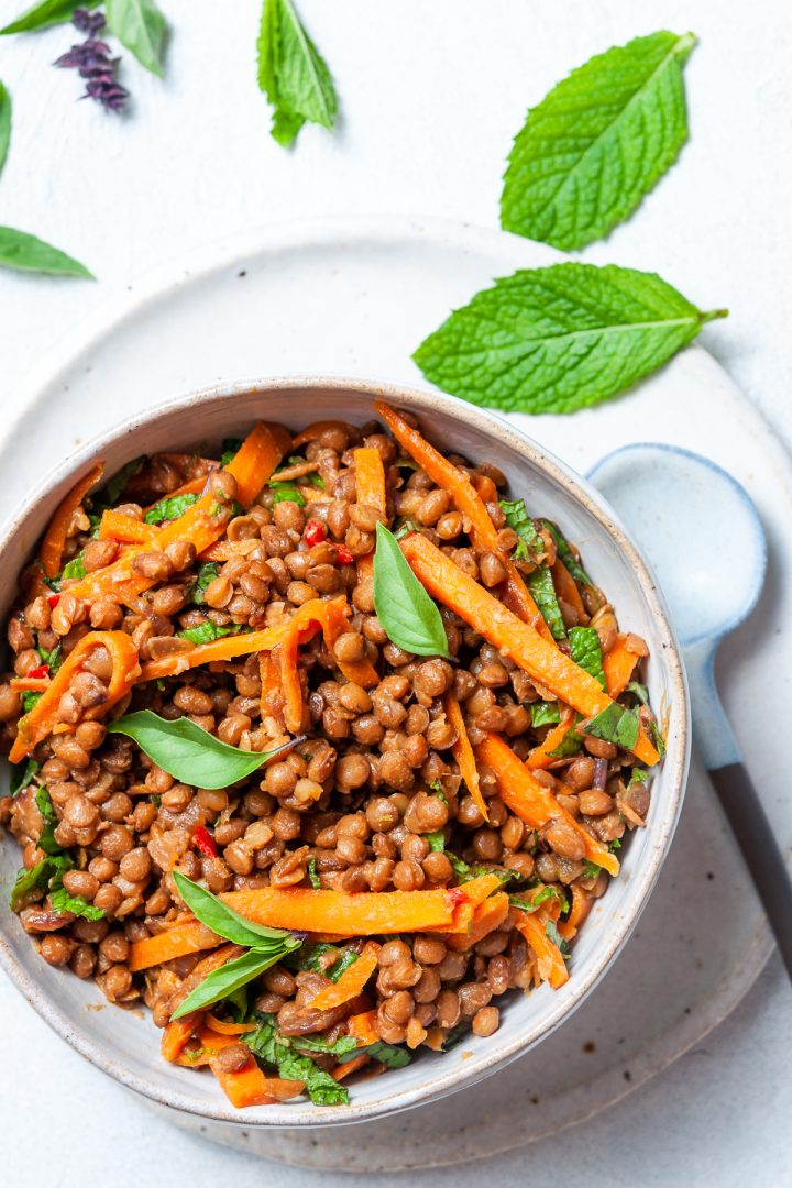 Close up overhead picture of vegan lentil filling with carrots and fresh herbs
