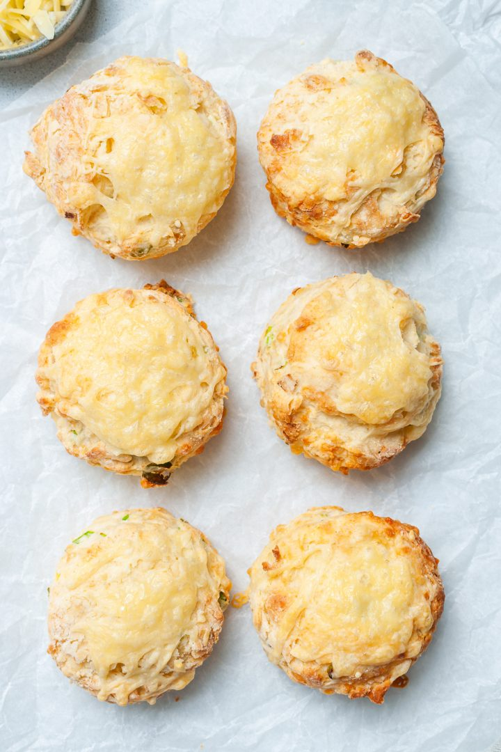 overhead shot of 6 cheese scones on white background