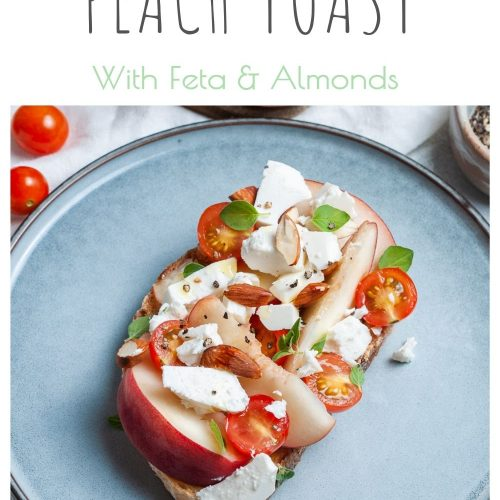 pin for healthy peach toast with a slice of toast on plate topped with feta, almonds, tomatoes and herbs