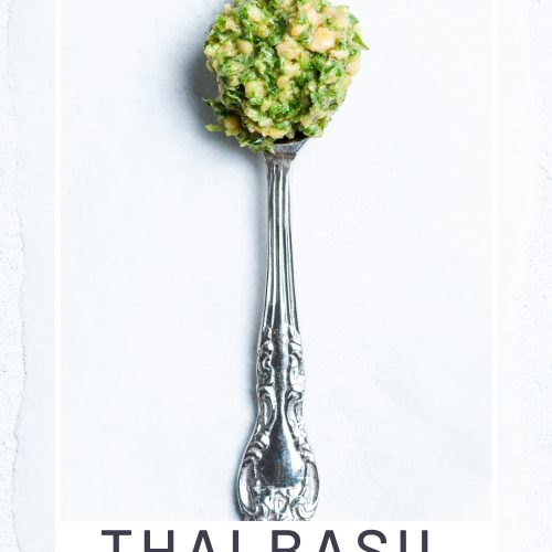 pin for Thai basil pesto with pesto on a spoon
