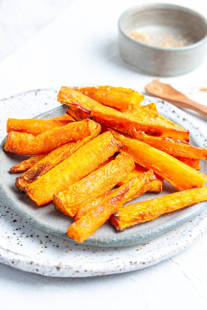Air fried carrots in cumin salt on plate ready to be eaten
