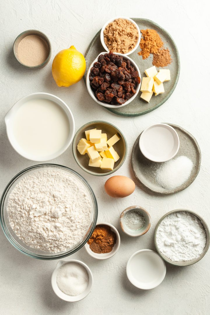 ingredients for hot cross bun scrolls and lemon icing laid out in bowls