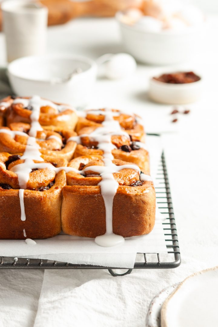 Side view of Easter hot cross buns with the icing dripping down the side