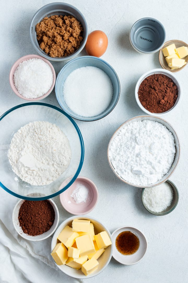 ingredients for the slice and icing laid out in individual plates and bowls
