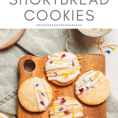 a pin for lemon shortbread cookies showing decorated cookies ready to be eaten