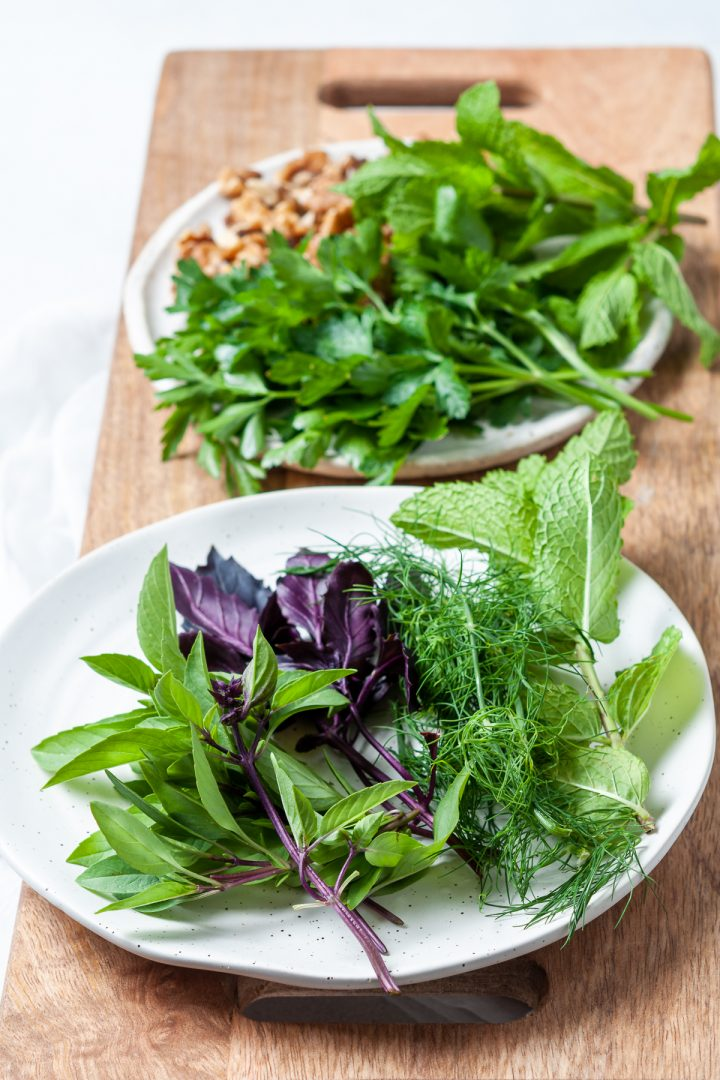 close up of fresh herbs used in the platter: purple basil, Thai basil, dill, mint and parsley