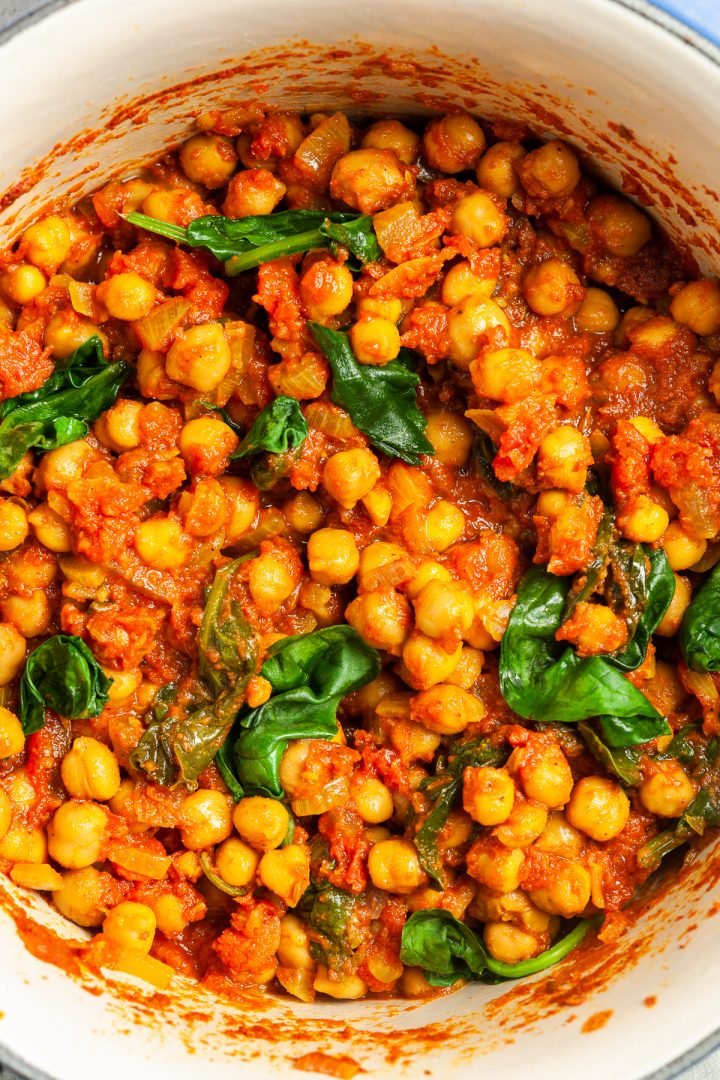 close up of the tomato chickpea curry in a saucepan, ready to serve