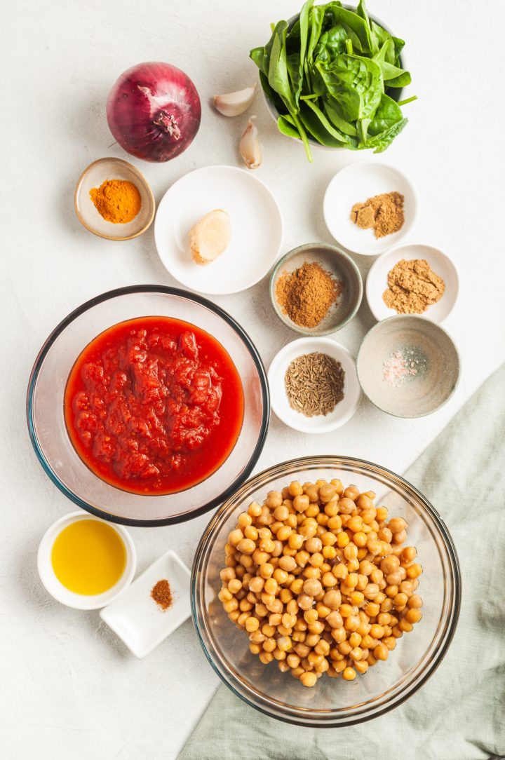 ingredients for Indian tomato chickpea curry laid out in individual bowls