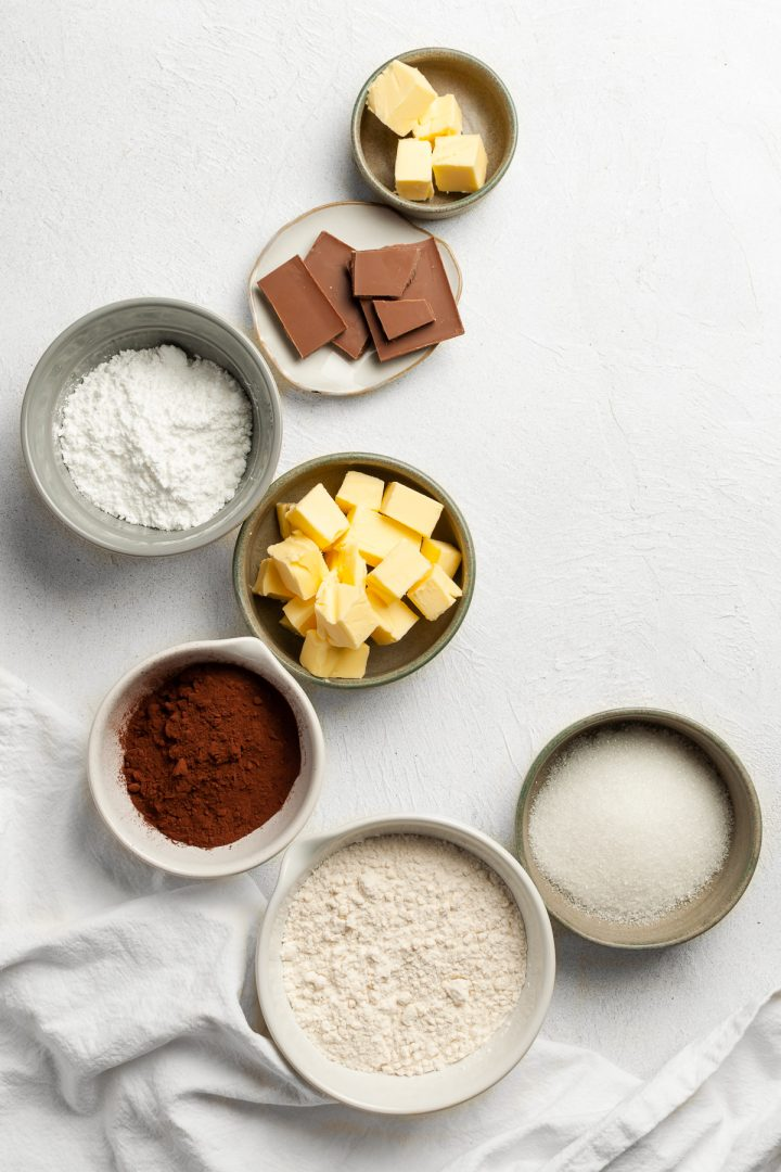 Overhead view of ingredients needed for making bourbon biscuits, all in individual bowls
