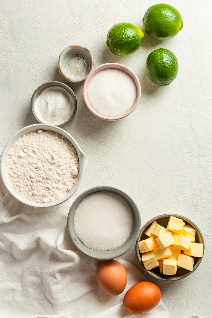 ingredients for lime drizzle cake laid out in individual bowls