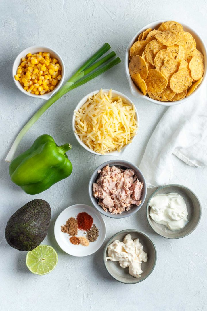 Ingredients needed to make tuna nachos laid out in individual bowls
