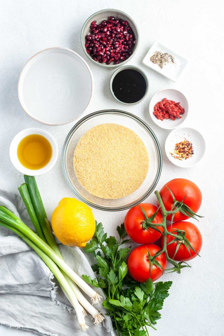 ingredients for kisir laid out in individual bowls