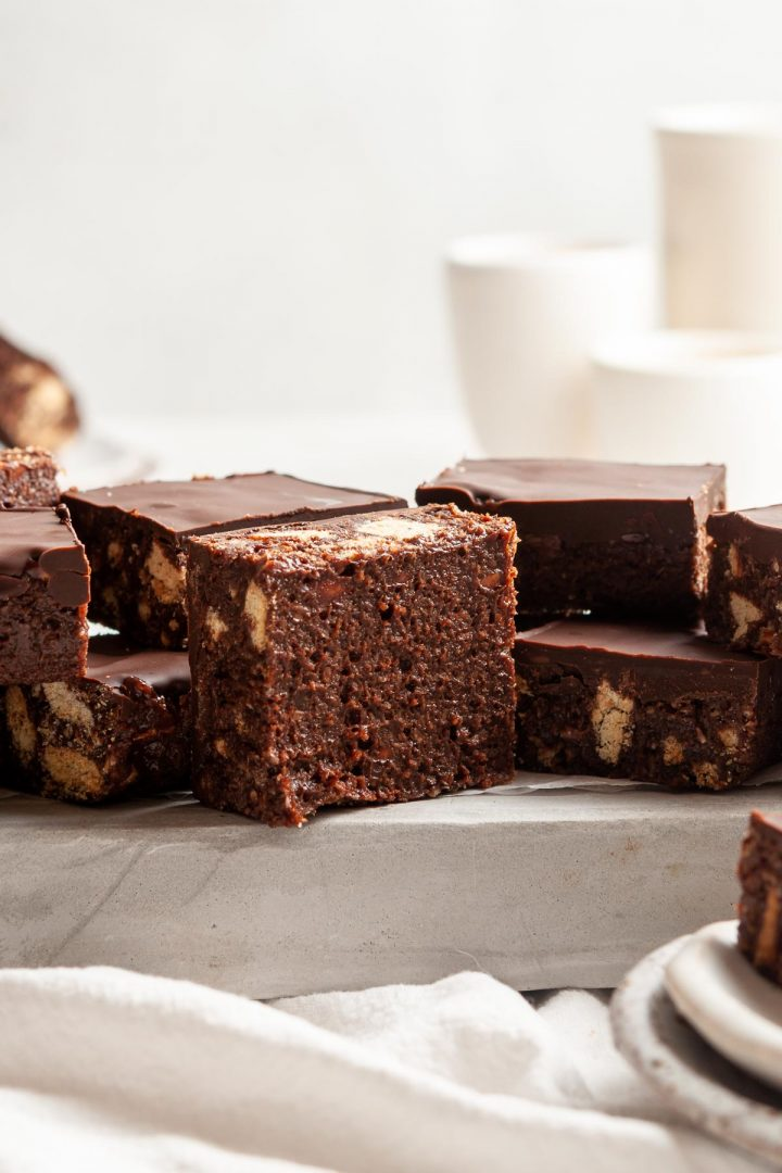 An upturned square of the chocolate slice to show the sticky fudgy and delicious base